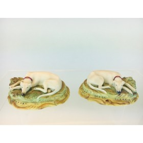 A Charming Staffordshire Pottery Rare Pair of Hand Painted Bisque Porcelain recumbent Whippets circa 1890